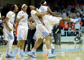 Jamie Cherry gets a lift after her buzzer-beater lifted the Tar Heels to a win over Ohio State and a berth in the Sweet 16.