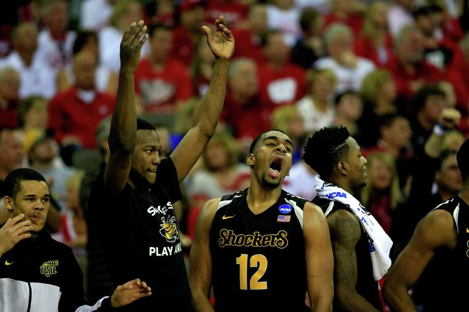 OMAHA, NE - MARCH 22: Darius Carter #12 of the Wichita State Shockers and teammates celebrate as they defeat the Kansas Jayhawks during the third round of the 2015 NCAA Men's Basketball Tournament at the CenturyLink Center on March 22, 2015 in Omaha, Nebraska.  (Photo by Jamie Squire/Getty Images) ORG XMIT: 527066039 Photo: Jamie Squire / 2015 Getty Images