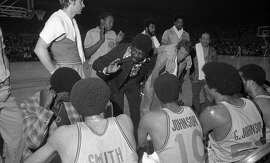 Coach Al Attles gives instructions to his Warriors during Game 2 of the 1975 NBA Finals against the Washington Bullets.