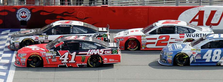 Kevin Harvick (4) leads on a restart in front of Kurt Busch (41), Brad Keselowski (2), and Jimmie Johnson (48) during the NASCAR Sprint Cup Series auto race in Fontana, Calif., Sunday, March 22, 2015. Keselowski won the race after a later green-white-checkered. Photo: Alex Gallardo, AP / FR170211 AP