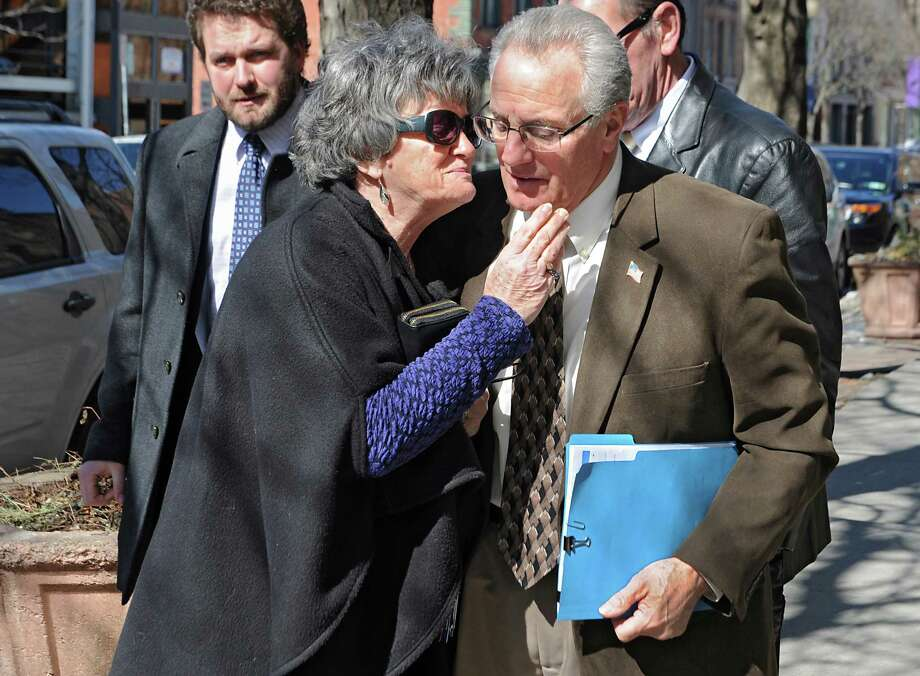 Mayor Lou Rosamilia is greeted by his wife Peg in front of the Infinity Cafe just before making the official announcement that he won't be running for office again on Monday, March 23, 2015 in Troy, N.Y.  (Lori Van Buren / Times Union) Photo: Lori Van Buren / 00031145A