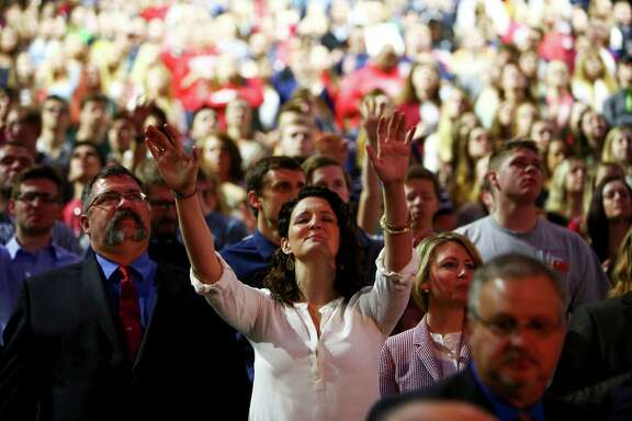 An attendee raises her hands as religious music plays onMonday before Sen. Ted Cruz announced at Liberty University, a private Christian school in Lynchburg, Va., that he will be a presidential candidate in 2016.