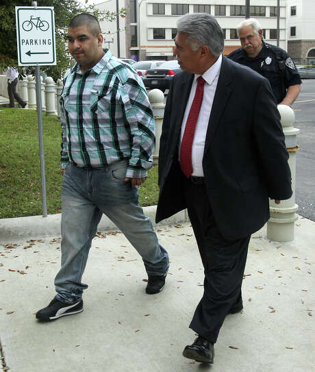 Rodrigo Pincon-Garcia (left), convicted of intoxicated assault of a public servant, walks with his attorney Victor Gomez on Thursday. Pincon-Garcia was sentence to 10 years. Photo: John Davenport /San Antonio Express-News / ©San Antonio Express-News/John Davenport