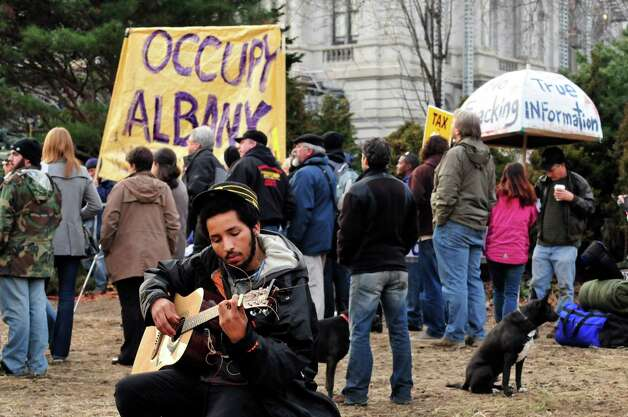 Serge, a self described homeless man, plays guitar during a rally to support Occupy Albany Saturday, Jan. 7, 2012, at Academy Park in Albany,NY.  (Michael P. Farrell/Times Union archive) Photo: Michael P. Farrell / 10016010A