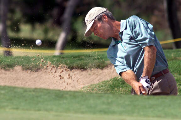 Ben Crenshaw, who won his pro debut at the 1973 Texas Open, blasts out of a greenside sand trap at No.15 at La Cantera, where the pro-am was played on Sept. 20, 2001.