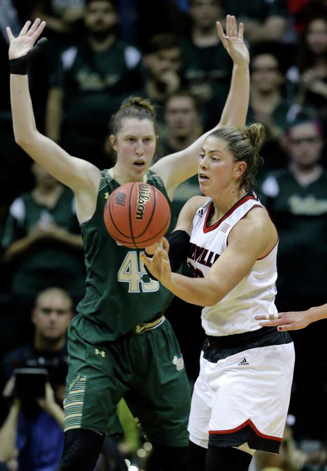 Louisville forward Sara Hammond (00) loses control of the ball in front of South Florida center Katelyn Weber (45) during the first half of a women's NCAA tournament second round basketball game Monday, March 23, 2015, in Tampa, Fla. (AP Photo/Chris O'Meara) ORG XMIT: TPA105 Photo: Chris O'Meara / AP