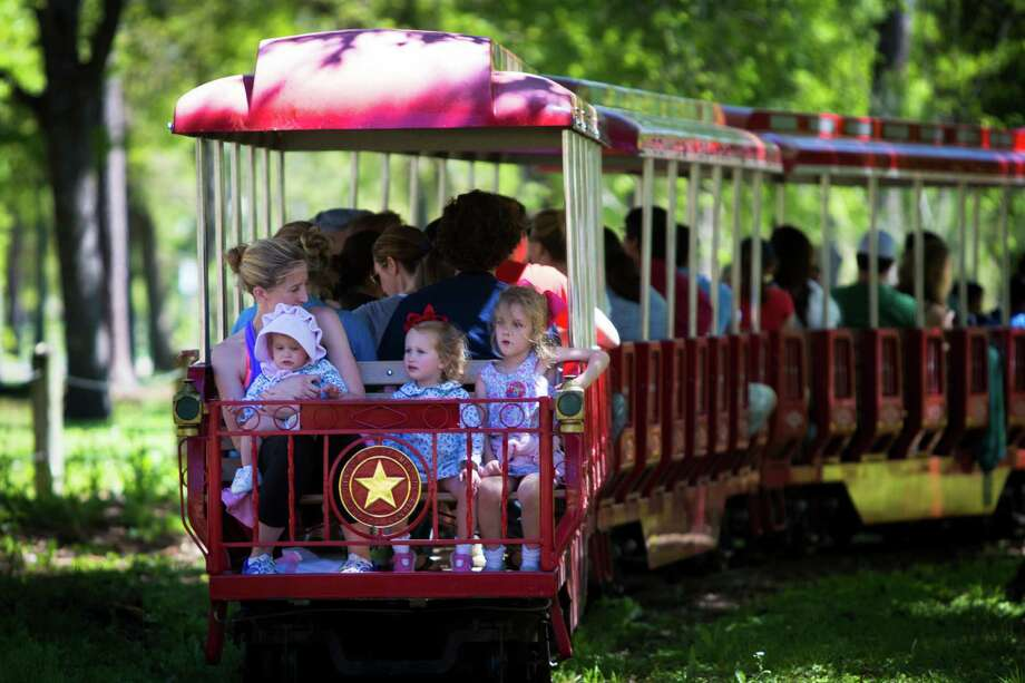 Deborah McInnes rides the train at Hermann Park with her daughters Annie Cate McInnes, 1, Mollie McInnes, 3, and Eloise McInnes, 5, taking full advantage of the sunny weather, Monday, March 23, 2015, in Houston. Photo: Marie D. De Jesus, Houston Chronicle / © 2015 Houston Chronicle