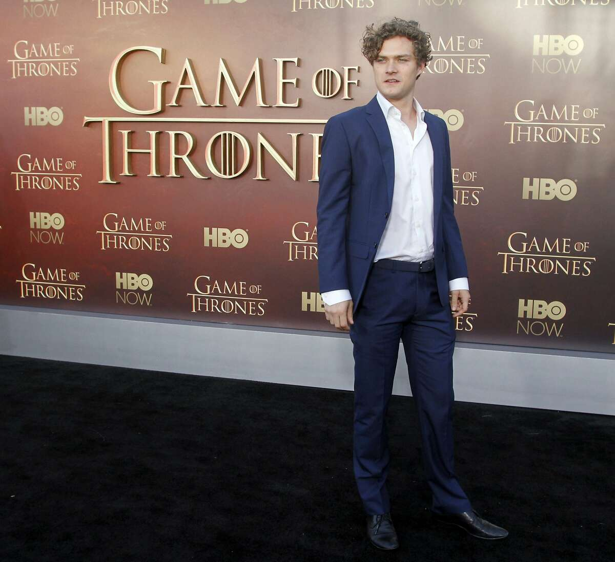 """Finn Jones arrives at the Season 5 premier of """"Game of Thrones"""" at the War Memorial Opera House, Monday, March 23, 2015, in San Francisco. (Photo/George Nikitin, Invision/AP)"""