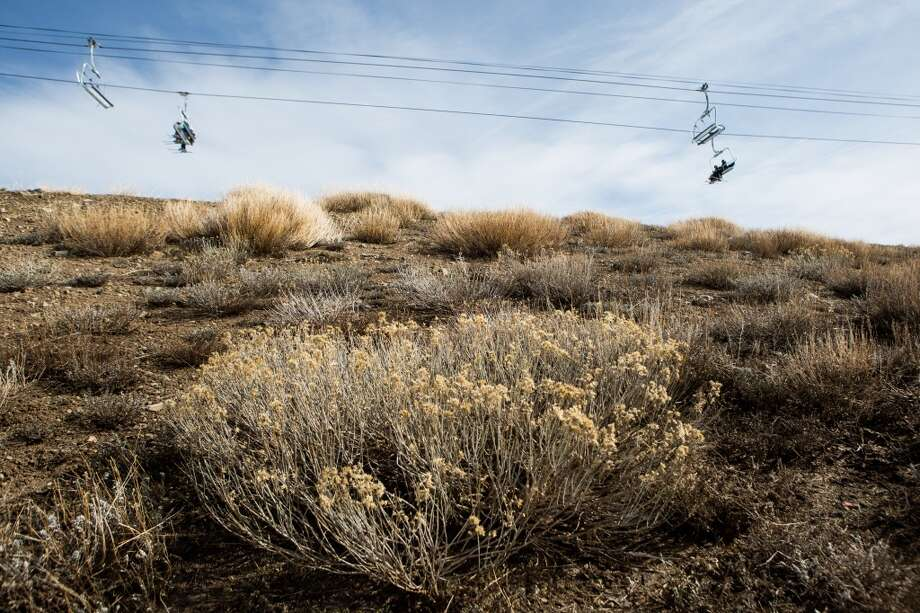 Skiers ride a chairlift over dry ground at Squaw Valley Ski Resort on Saturday, March 21, 2015, in Olympic Valley, Calif. Photo: Max Whittaker, Getty