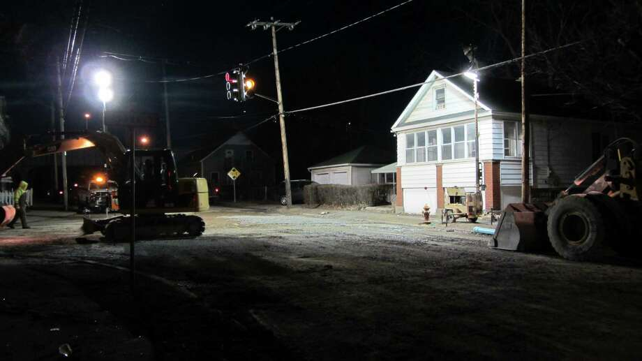 A Rensselaer highway crew was at work early Tuesday to repair a water main break in the intersection of East and Adams streets in the city of Rensselaer. Those streets are closed and detours are in place between the Amtrak station and Third Avenue. (Skip Dickstein / Times Union)