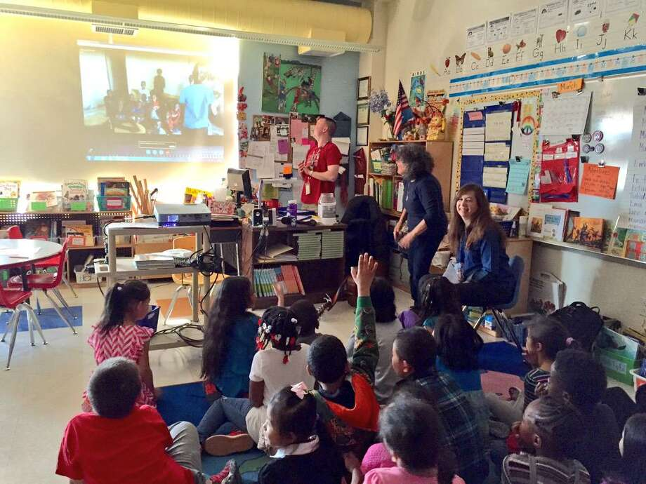 Susan Fowler's second grade in Albany's Delaware Community School used Skype to talk with orphans in Kampala, Uganda, on Tuesday. (Skip Dickstein / Times Union)