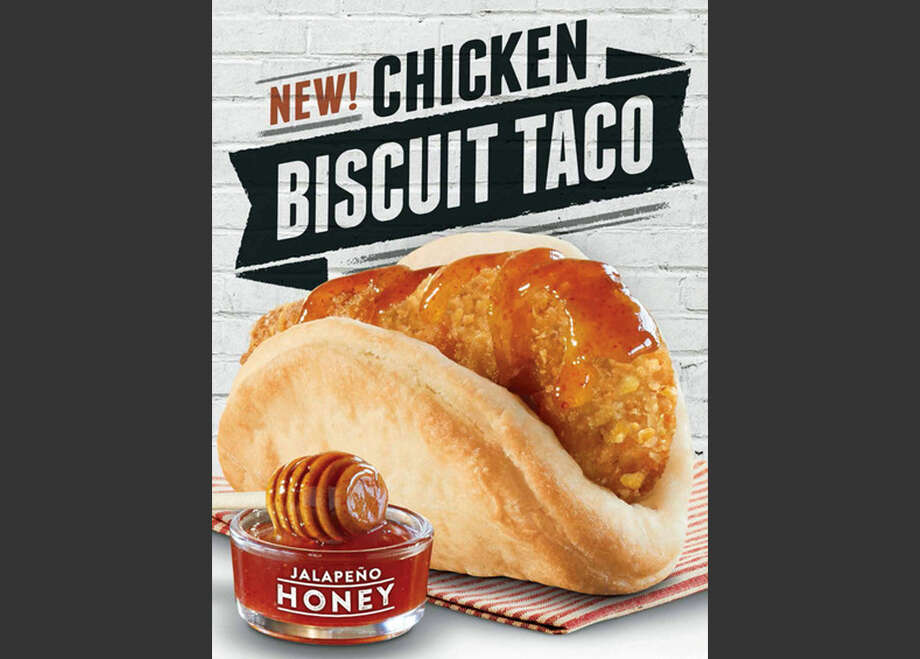 "This image provided by Taco Bell shows an ad shows the restaurant chain's new chicken ""biscuit taco"". Taco Bell's new ad campaign promoting its the new offering aims to paint McDonald's Egg McMuffins as boring, routine food for the brainwashed. Photo: Uncredited, AP / Taco Bell"