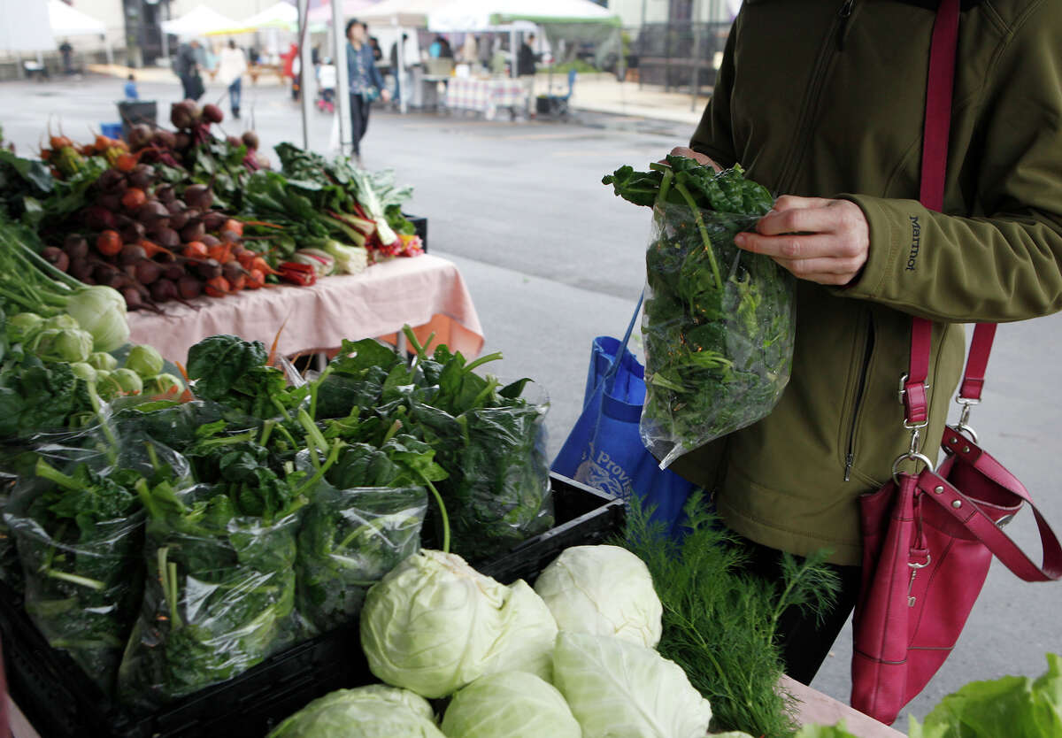 Spinich is bought from Zamudio Fams Sunday, March 8, 2015 at the Yard Farmers and Ranchers Market. The Yard Farmers and Ranchers Market runs from 9 a.m. to 1 p.m. on Sundays in the Yard Shopping Center off of McCollough Avenue.