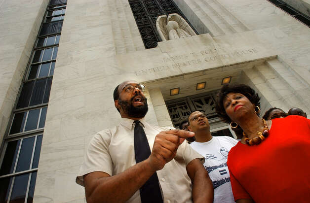 Aaron Mair, president of the Environmental Justice Corporation board of directors, left, and Anne Pope, president of the Albany NAACP, speak at a press conference on Albany County redistricting outside the James T. Foley United State Court House Tuesday JULY 8, 2003, in Albany, N.Y. (Michael P. Farrell/Times Union) Photo: MICHAEL P. FARRELL / ALBANY TIMES UNION