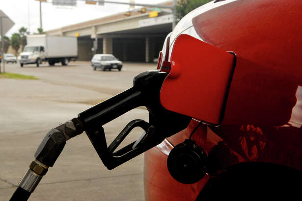 A car gets gasoline at an Exxon station in Brownsville, Texas in this file photo. (AP Photo/The Brownsville Herald, Brad Doherty)