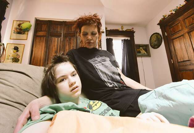 "Tanya Moran and her 14-year-old daughter, Rockelle ""Rocky"" Valentino, on Tuesday. Moran says someone took her daughter's wheelchair from her driveway. (Skip Dickstein / Times Union)"