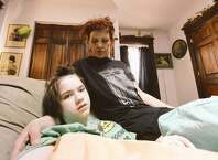 """Tanya Moran and her 14-year-old daughter, Rockelle """"Rocky"""" Valentino, on Tuesday. Moran says someone took her daughter's wheelchair from her driveway. (Skip Dickstein / Times Union)"""
