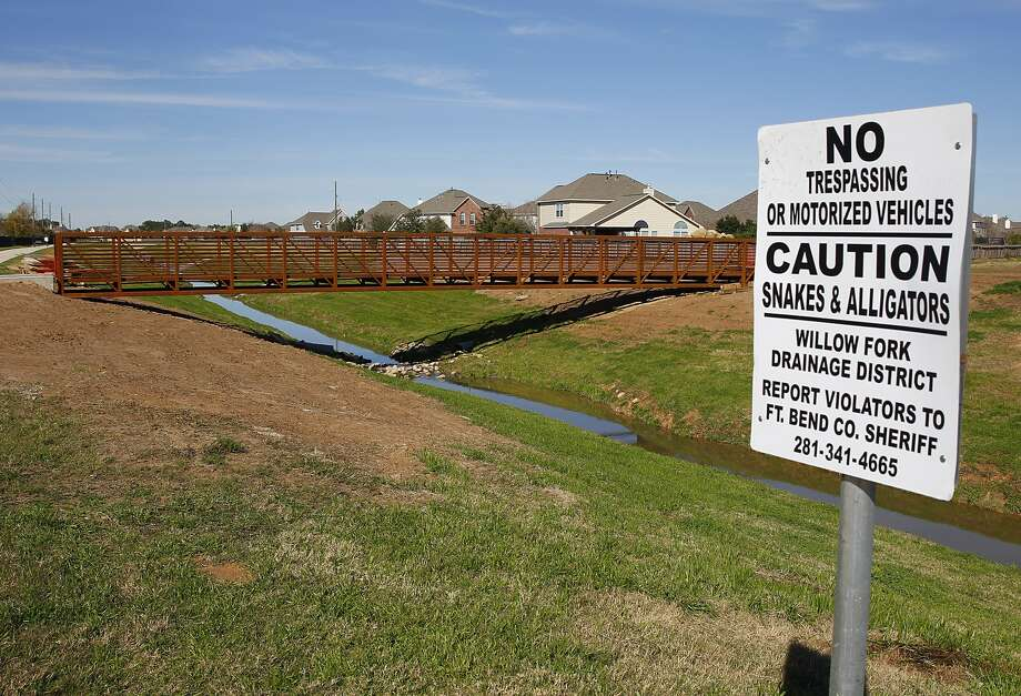A new constructed footbridge in Katy spans a reservoir managed by the Willowfork Drainage District. The bridge project was spearheaded by the Falcon Ranch Home Owners Association for safety reasons. Photo: Diana L. Porter, Freelance / © Diana L. Porter