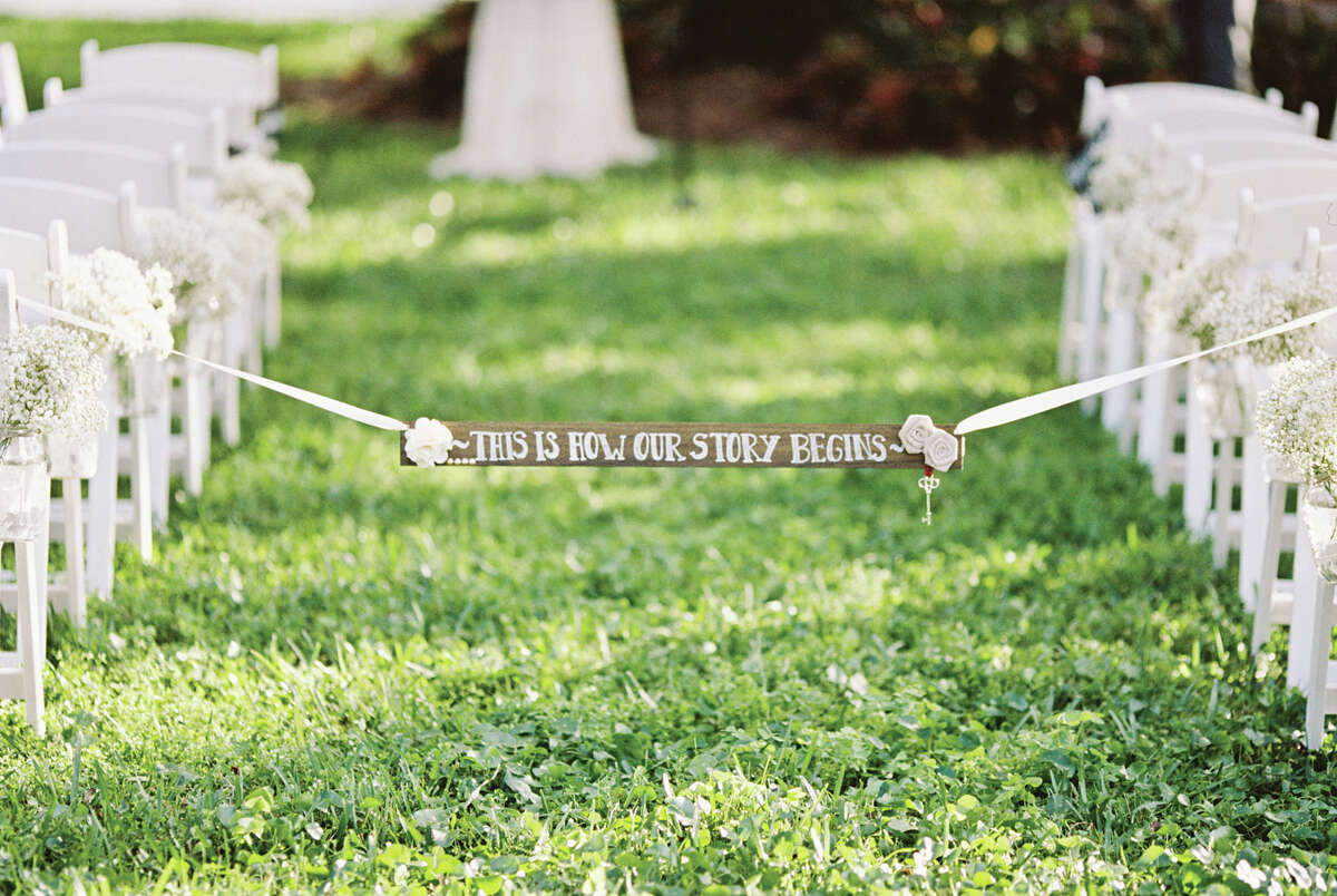 Custom signage is also increasingly popular. Couples display cute love quotes through out the ceremony and reception