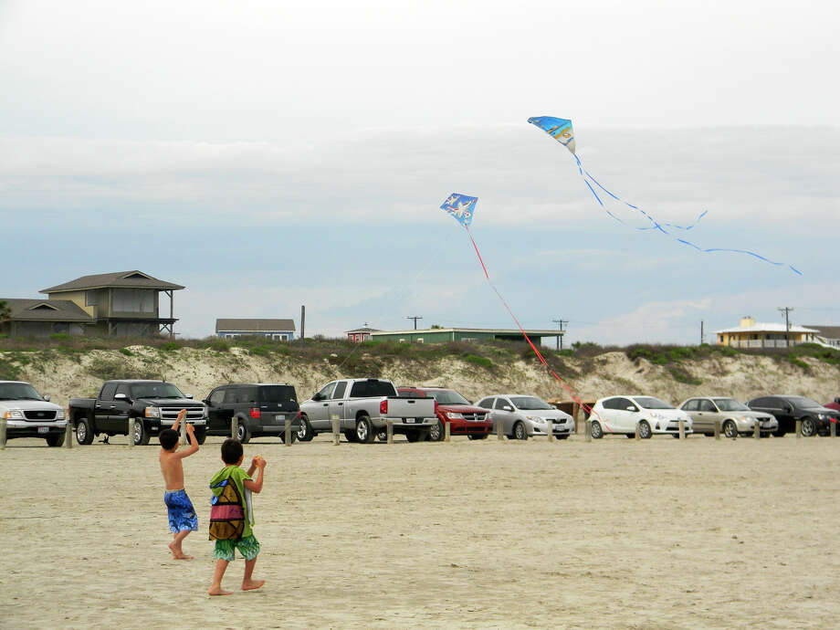 Two boys fly kites on the beach at Port Aransas. Photo: Express-News File Photos / San Antonio Express-News