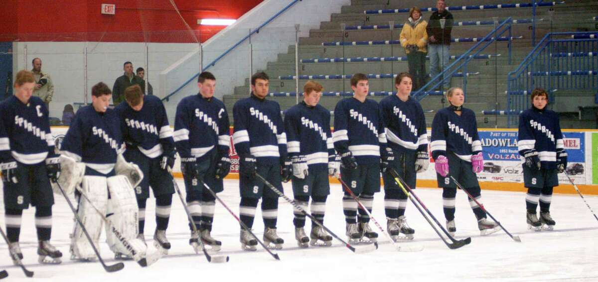 The Spartans wait during introductions for the game's start before Shepaug Valley/Litchfield/Nonnewaug co-op's 4-2 victory over Brookfield/Bethel/Danbury in the first round of the state Division III ice hockey tournament at the Danbury Ice Arena. March 9, 2015