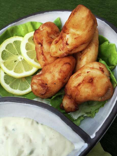 Crispy Lemon Fish begins with an easy-t0-make batter of lemonade, lemon zest and flour. Photo: POST / Washington Post / THE WASHINGTON POST