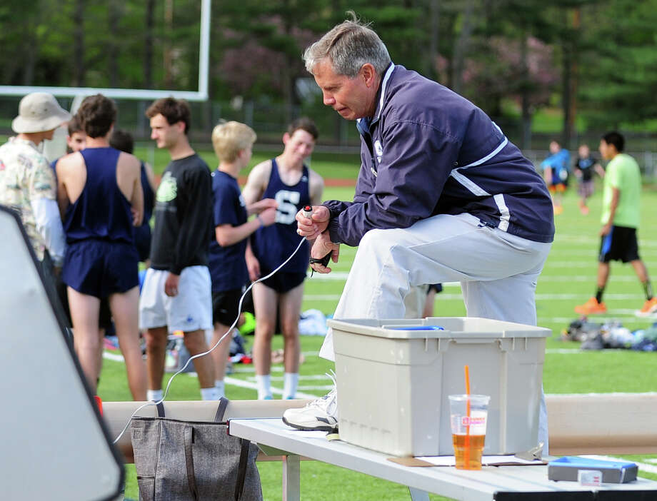 Staples' Track Coach Laddie Lawrence, during boys track action against Westhill and Trumbull in Trumbull, Conn. on Tuesday May 13, 2014. Photo: Christian Abraham / Connecticut Post