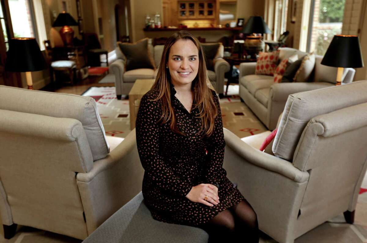 Kelly Hackett, now VP of the Hackett Family Foundation and Family Office Director of Salient Partners, at her mother's home Tuesday, Feb. 17, 2015, in Houston, Texas. ( Gary Coronado / Houston Chronicle )