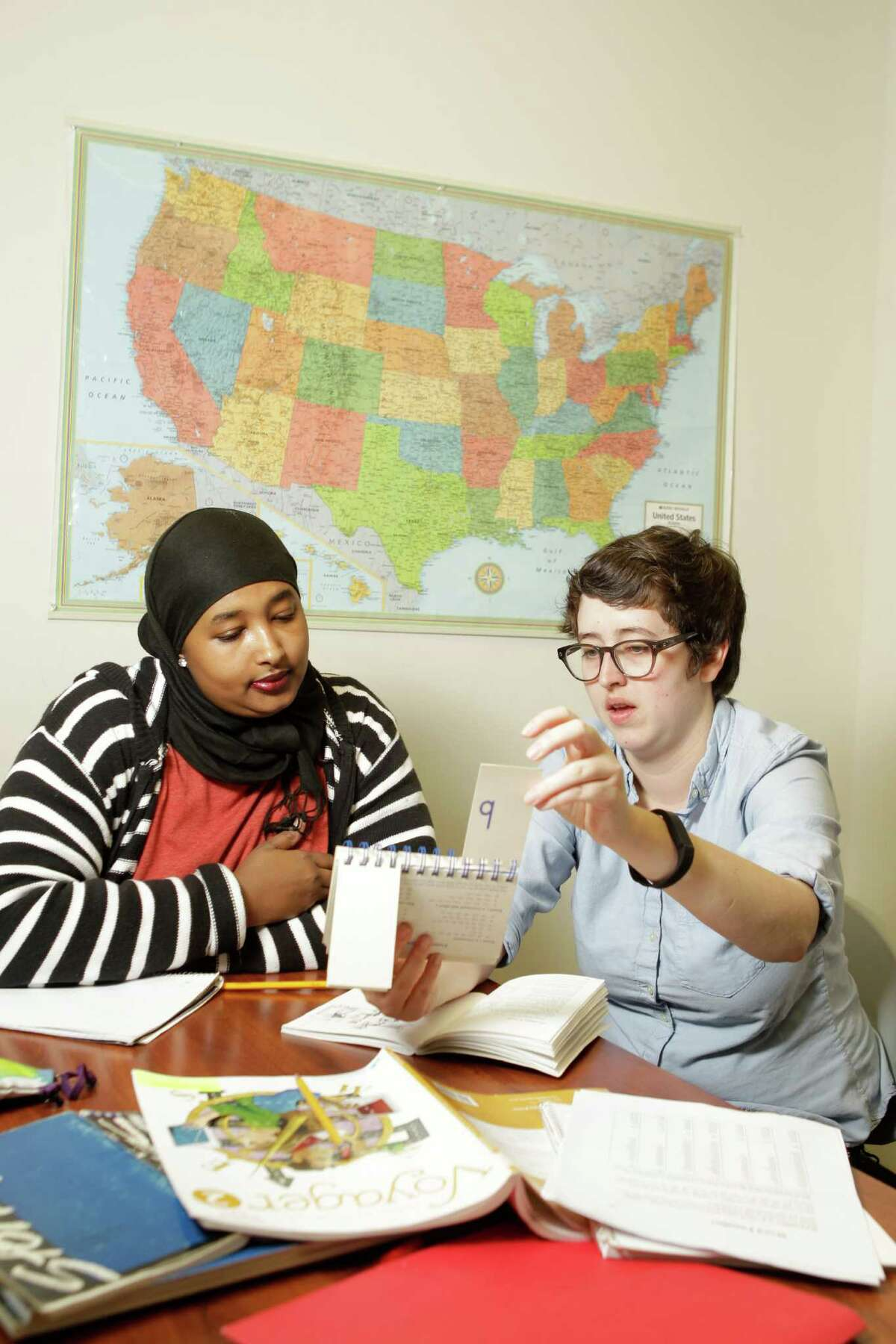 Hasana Hawadleh, left, is tutored by volunteer Brett Hanley at the Literacy Advance of Houston, 2424 Wilcrest Drive, Saturday, Feb. 21, 2015, in Houston. ( Melissa Phillip / Houston Chronicle )