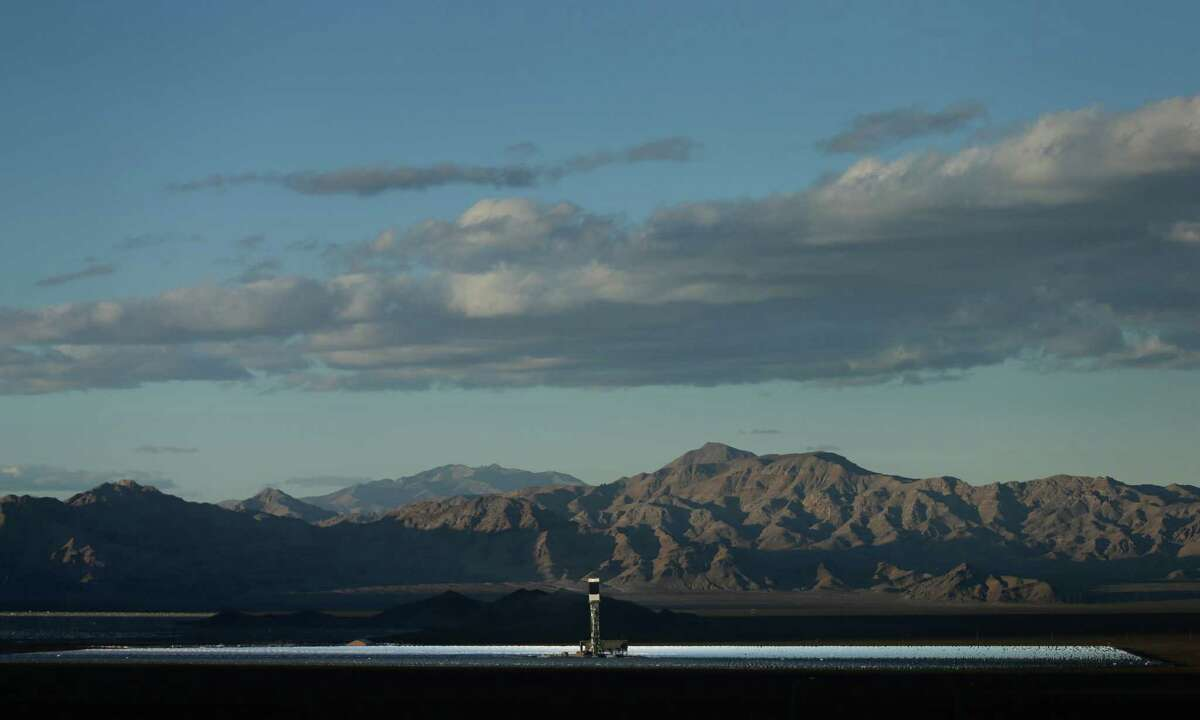 California has become the first state to get 5 percent of its electricity from large-scale solar facilities, such as the Ivanpah solar power plant in the Mojave Desert. (AP Photo/Chris Carlson)