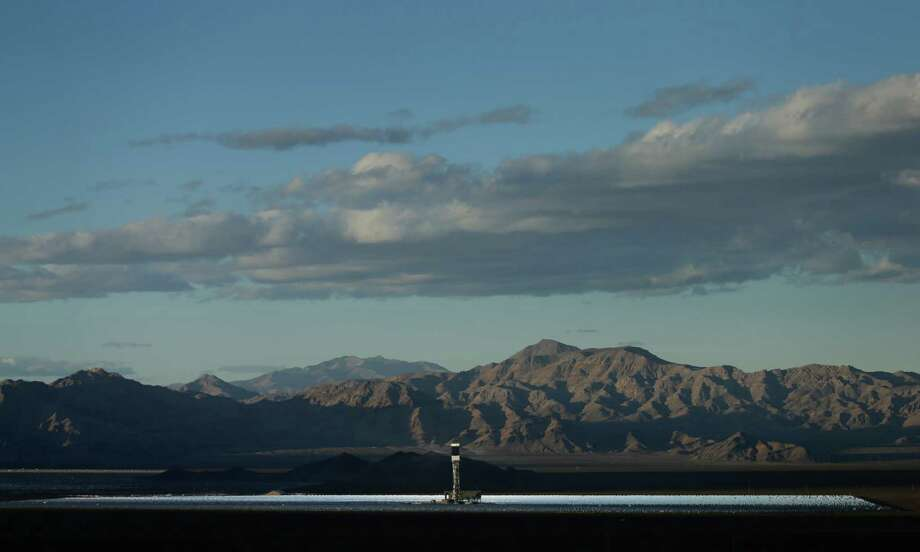 California has become the first state to get 5 percent of its electricity from large-scale solar facilities, such as the Ivanpah solar power plant in the Mojave Desert. (AP Photo/Chris Carlson) Photo: Chris Carlson / Chris Carlson / Associated Press / AP