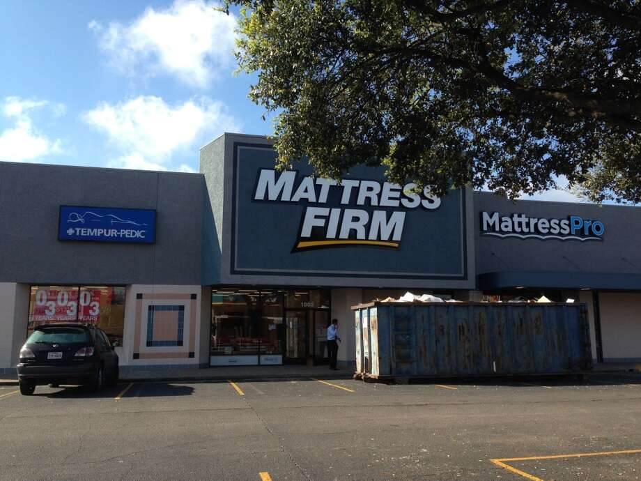 Mattress Firm is now open in the former Blockbuster Video space and a Mattress Pro store will soon open next door. Photo: Katherine Feser, Houston Chronicle