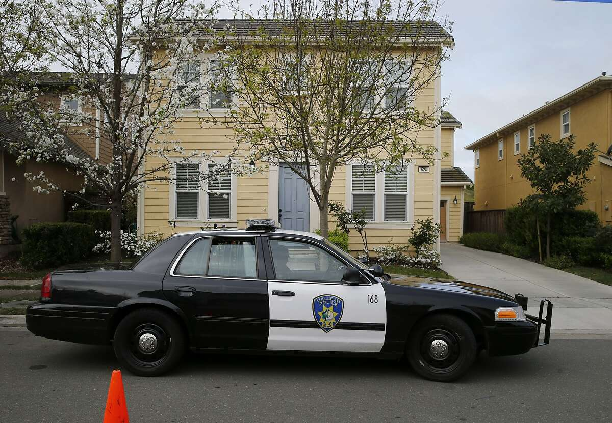 A Vallejo police department officer sits in front of the home of Denise Huskins, the apparent kidnap victim, on Kirkland Avenue on Mare Island Tuesday March 24, 2015. The Vallejo, Calif. police department says Denise Huskins, a Kaiser physical therapist, is the apparent victim of a kidnapping for ransom.