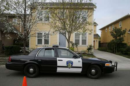 A Vallejo Police Department officer sits in front of the home of Denise Huskins, the apparent kidnap victim, on Kirkland Avenue on Mare Island on March 24.