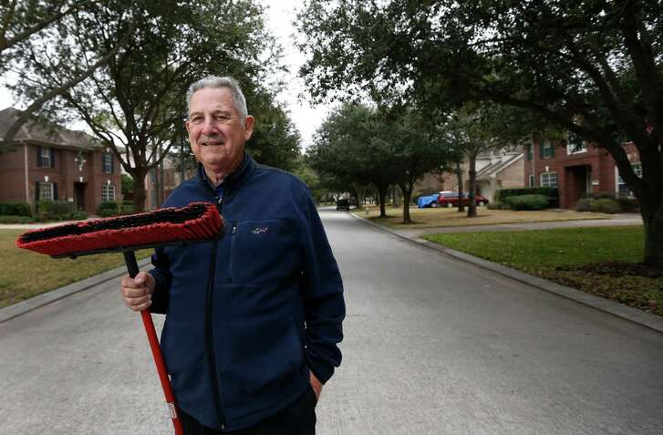 Al Pessarra in the middle of his street, Thursday, Feb. 5, 2015, in Houston.  Pessarra is the best neighbor anyone could have. He helps folks with their yards, trimming trees and mowing lawns and cleaning out the acorns that accumulate in the street. He's also a fixture at Tallowood Baptist Church and he loves auctions, bargaining for leftover spoils that might be useful to people in need. But he did a truly special thing for neighbor Barbara DeAinza, soon after she moved in. While walking her dogs, Barbara had a heart attack and Al got her to the emergency room in Memorial City.  ( Karen Warren / Houston Chronicle  )
