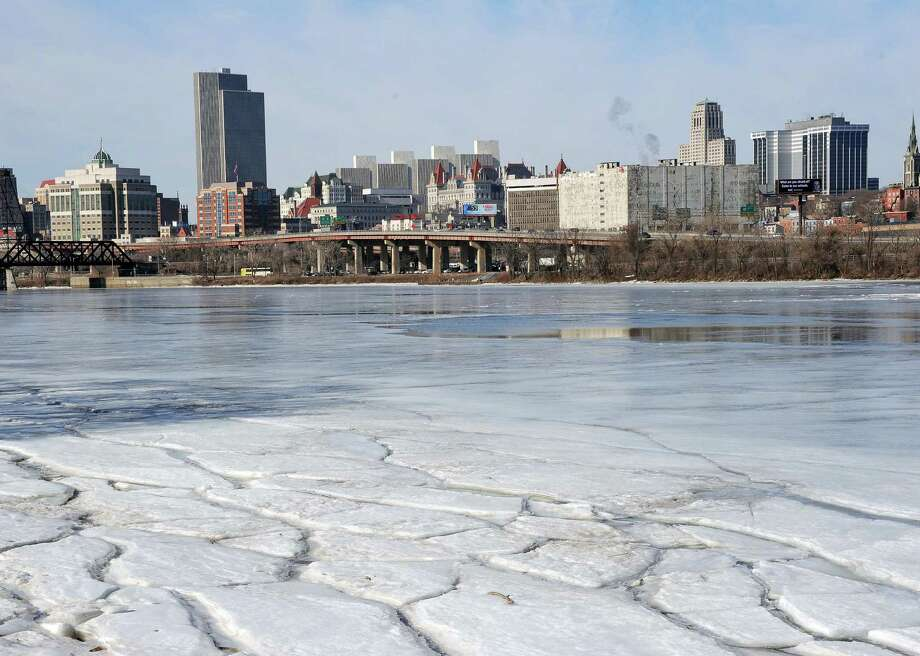Ice in the Hudson River can be seen to be breaking up in this view of Albany from the boat launch Tuesday March 24, 2015 in Rensselaer, NY.   (John Carl D'Annibale / Times Union) Photo: John Carl D'Annibale