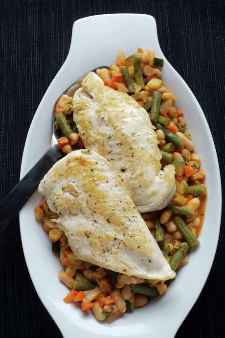 Chicken With Provencal White Bean and Vegetable Ragout is quick. Cleanup is easy: As soon as chicken is ready, re-use it for the sides. Photo: Washington Post / THE WASHINGTON POST