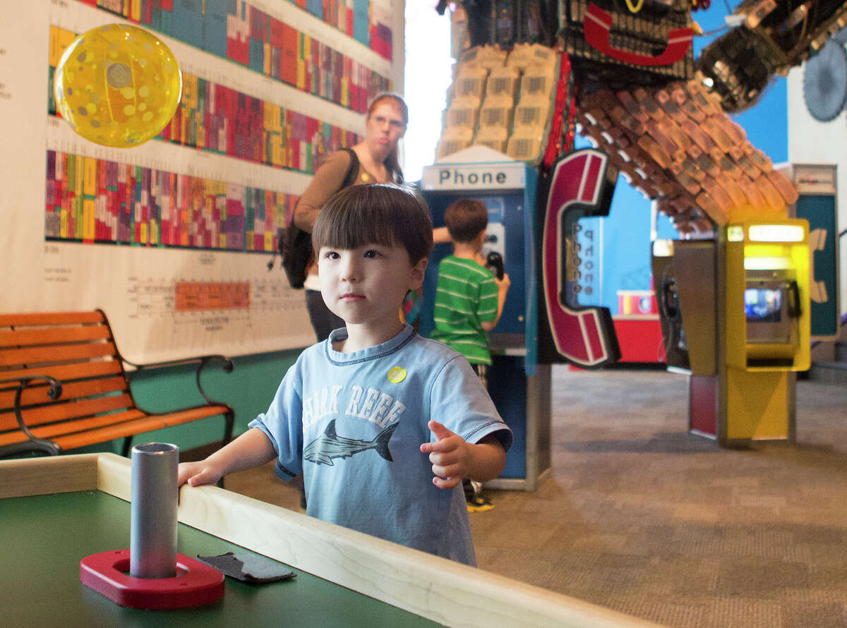 Isaiah L. 3, watches a floating ball in the Newton Know-How exhibit at the Children's Museum of Houston.