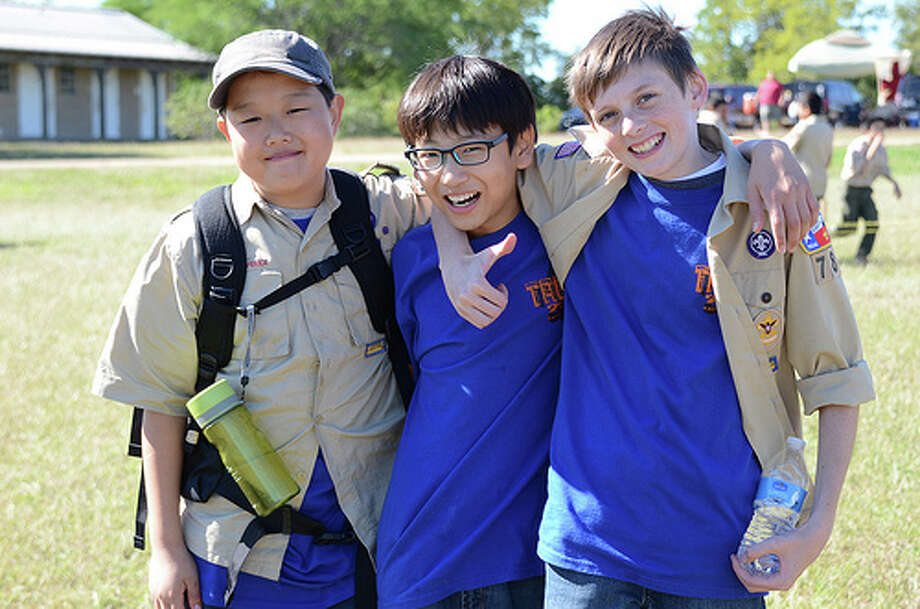 Whether volunteering time or money, choose a favorite cause, such as the Boy Scouts. Conner Chung, left, Jun Kim and Jacob High of Troop 780 participate in a camporee hosted by the Church of Jesus Christ of Latter-day Saints. Photo: Tom Kunz Courtesy Photos