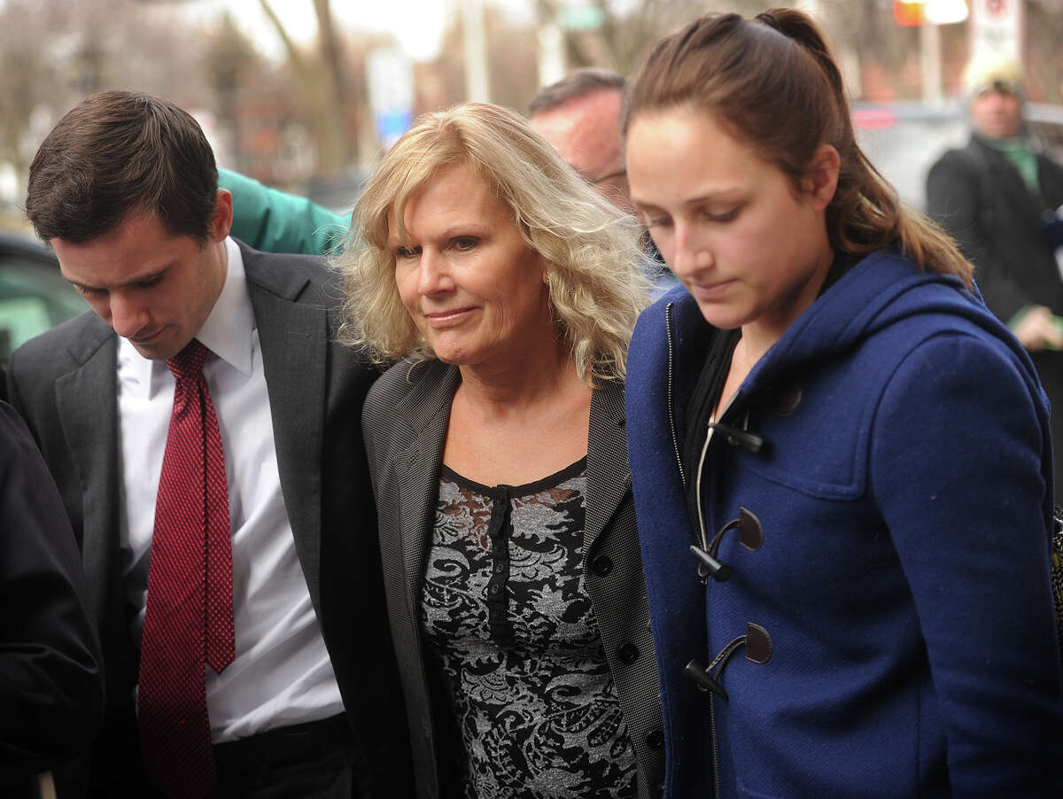 Former 5th Congressional District candidate Lisa Wilson-Foley, center, exits U.S. District Court in New Haven, Conn. after being sentenced to five months in prison for conspiracy to make illegal campaign contributions on Tuesday, March 24, 2015.