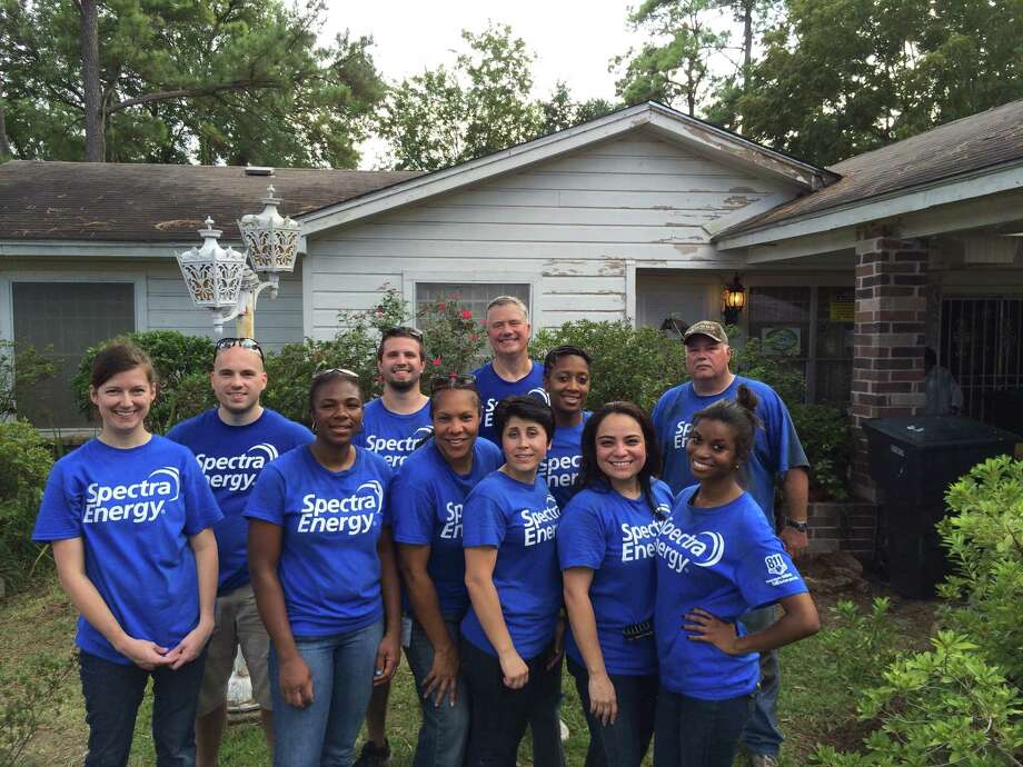 A group of Spectra Energy volunteers helped improve an overgrown yard for an elderly veteran and his wife for September's United Way Day of Caring. Photo: Spectra/United Way