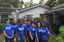 A group of Spectra Energy volunteers helped improve an overgrown yard for an elderly veteran and his wife for September's United Way Day of Caring.