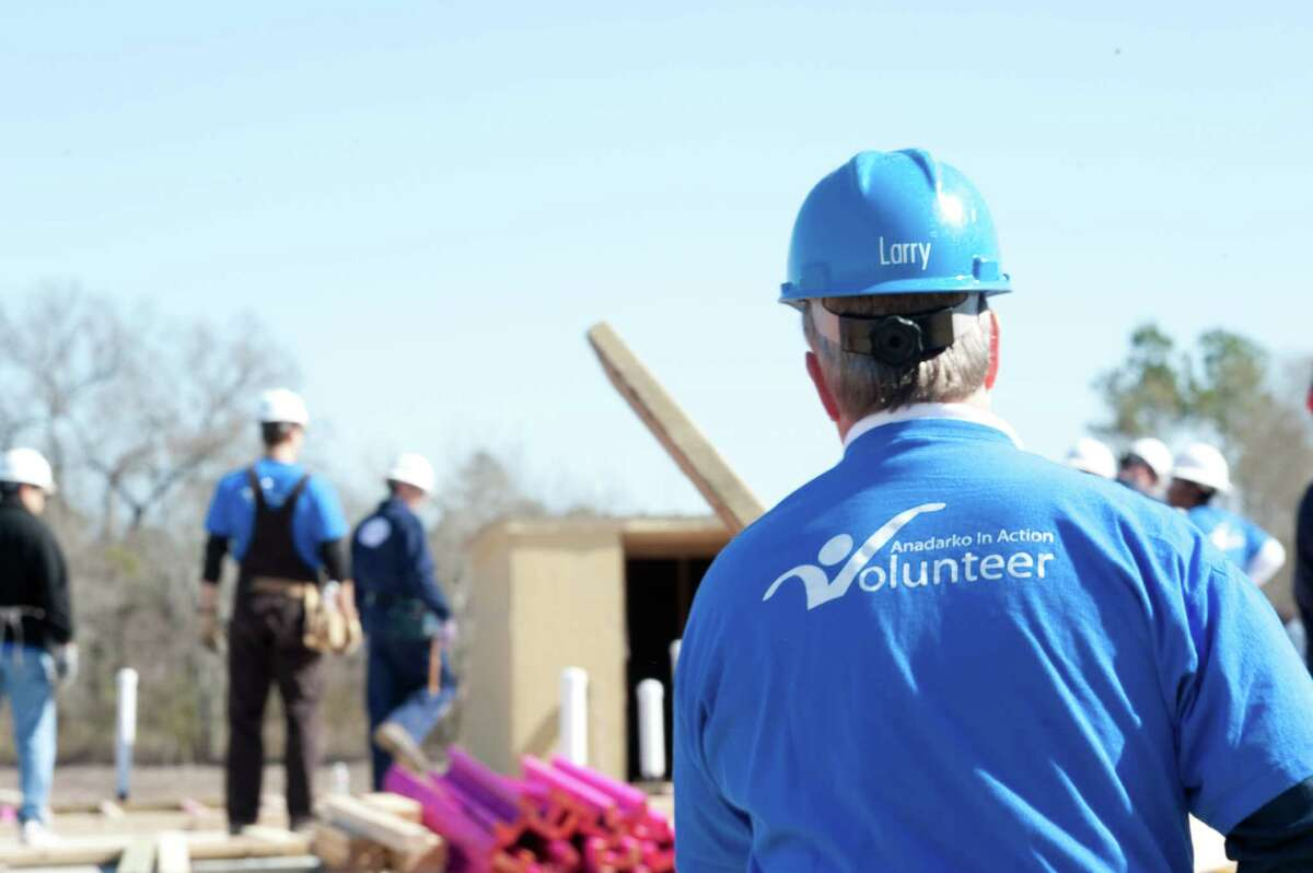 Larry Abston and other Anadarko volunteers work on a Habitat for Humanity project. Anadarko employees have dedicated thousands of hours to build homes in Montgomery County.
