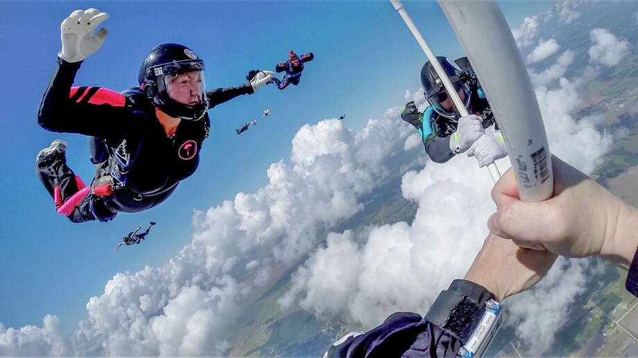 Marian Sparks, left, at the Jump for the Rose Pinkfest Mini Boogie in August at Skydive Spaceland. Photo: Chad Hall / Special to the Chronicle