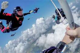 Marian Sparks, left, at the Jump for the Rose Pinkfest Mini Boogie in August at Skydive Spaceland.