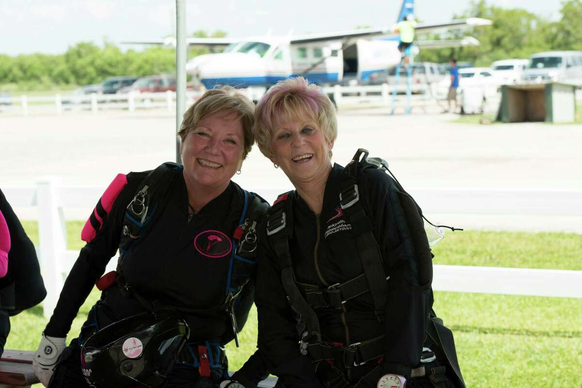 Sparks, left, joins Donna H. Mittendorf, chair of the Rose's board of directors, who made her first tandem jump at the event.