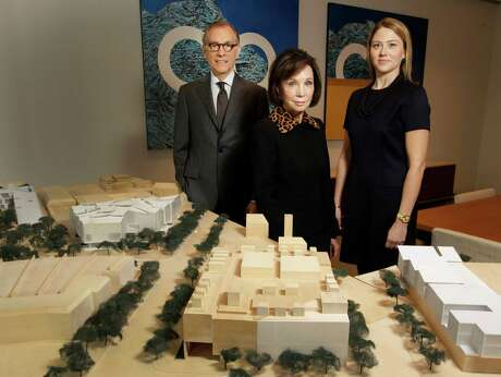 Gary Tinterow, from left, director of the Museum of Fine Arts, Houston; Cornelia Long, capital campaign chair; and Amy Purvis, development director, present a model showing the institution's campus expansion plan.