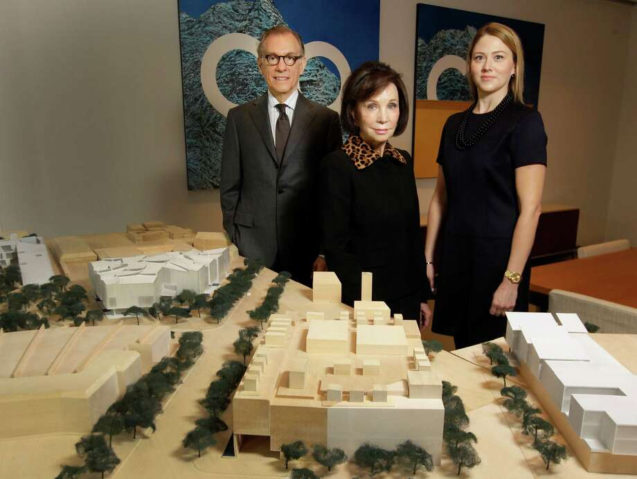 Gary Tinterow, from left, director of the Museum of Fine Arts, Houston; Cornelia Long, capital campaign chair; and Amy Purvis, development director, present a model showing the institution's campus expansion plan. Photo: Melissa Phillip, Staff / © 2014  Houston Chronicle