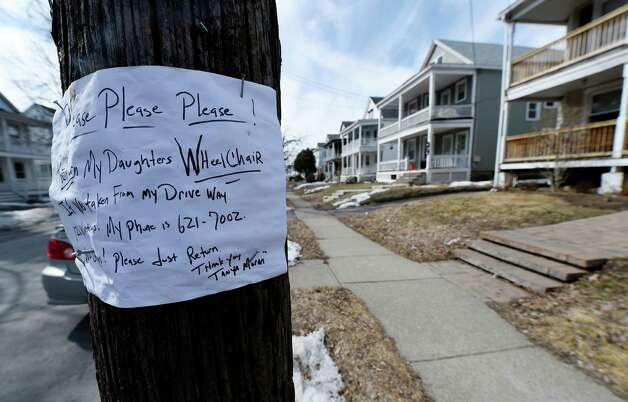A sign posted on a utility pole near 126 Winthrop Avenue puts forth the message of a stolen wheelchair and a number to call if found Tuesday morning March 24, 2015 in Albany, N.Y.     (Skip Dickstein/Times Union) Photo: SKIP DICKSTEIN