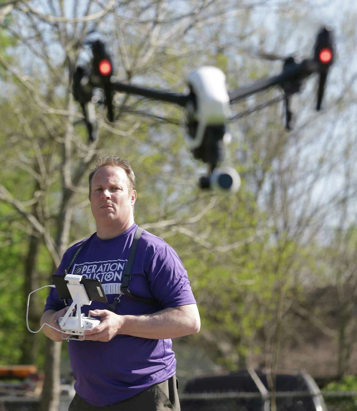Tom McPhee with World Animal Awareness controls a camera-equipped drone to document stray dogs in the Sunnyside area